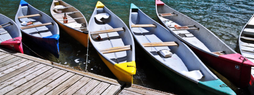 colorful canoes at a dock
